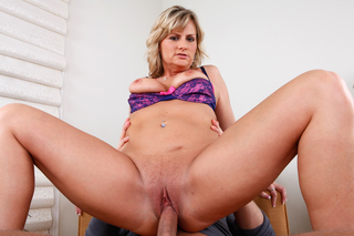 Sexy MILF Becca Blossoms rides a hard cock from Naughty America
