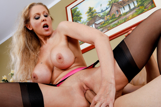 Julia Ann fucks her sons friend on the couch from Naughty America