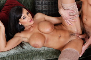Lisa Ann swallows some cock from Naughty America