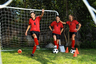 Three sexy girls warm up on the soccer field from Naughty America